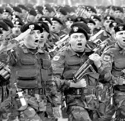 Members of the Black Berets, the Chilean army elite commando unit, march by the presidential stand during an Independence Day military parade in O'Higgings Park in Santiago, Chile, Tuesday, Sept. 19, 2000. (AP Photo/Santiago Llanquin)